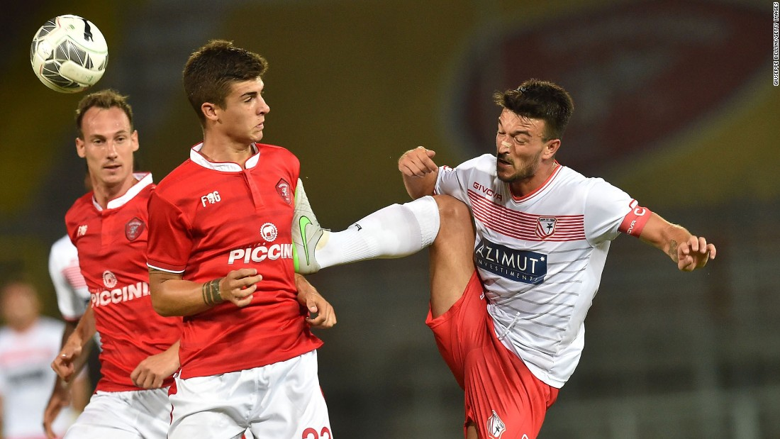 The high boot of Carpi's Raffaele Bianco hits Perugia's Gianluca Mancini during a preseason match in Perugia, Italy, on Saturday, August 1.