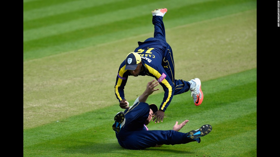 "Hampshire fielder Michael Carberry, top, catches a ball to dismiss a Glamorgan batsman during a One-Day Cup cricket match in Cardiff, Wales, on Sunday, August 2. <a href=""http://www.cnn.com/2015/07/28/sport/gallery/what-a-shot-sports-0728/index.html"" target=""_blank"">See 37 amazing sports photos from last week </a>"