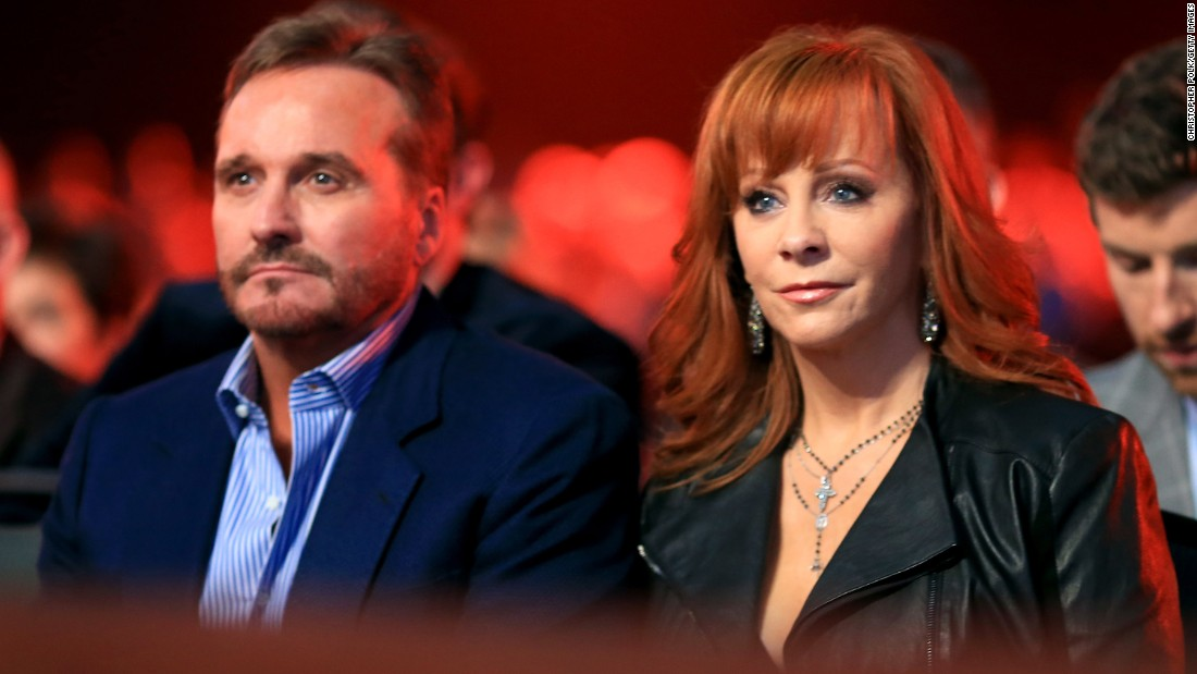 "After 26 years of marriage,<a href=""http://www.cnn.com/2015/08/03/entertainment/reba-mcentire-split/index.html""> Narvel Blackstock and Reba McEntire</a> divorced on October 28, after a separation of a few months, McEntire announced in late December. Though their marriage has ended, the couple will continue to work together. Blackstock is McEntire's manager."