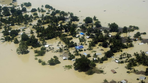 Floodwater inundates houses and vegetation in Kalay on August 2. The toll from flash floods and landslides in Myanmar after days of torrential rain is likely to spike, the U.N. warned, as monsoonal downpours continue across the region.