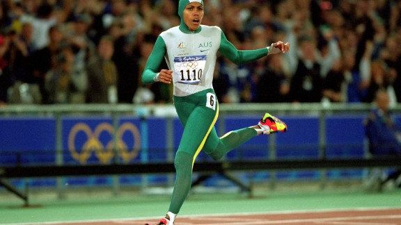 Cathy Freeman delighted Australian fans by winning the women's 400m, becoming the first athlete to light the Olympic torch and take a gold medal at the same Games.