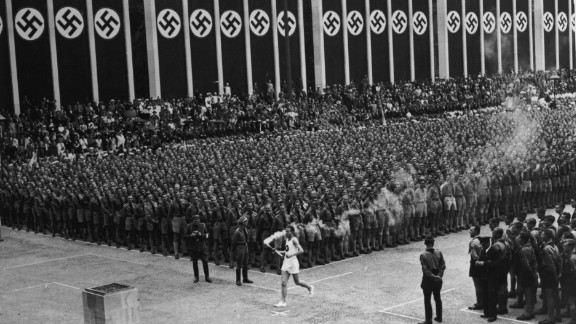 These Games will forever be associated with Adolf Hitler and his brutal regime. Germany's Fuhrer viewed it as an ideal opportunity to show the supremacy of the Aryan race, but American Jesse Owens flew in the face of such prejudices by winning four gold medals -- three in sprint events and one in the long jump. The first torch relay was held, with the flame carried from Mount Olympus to the Olympic Stadium.
