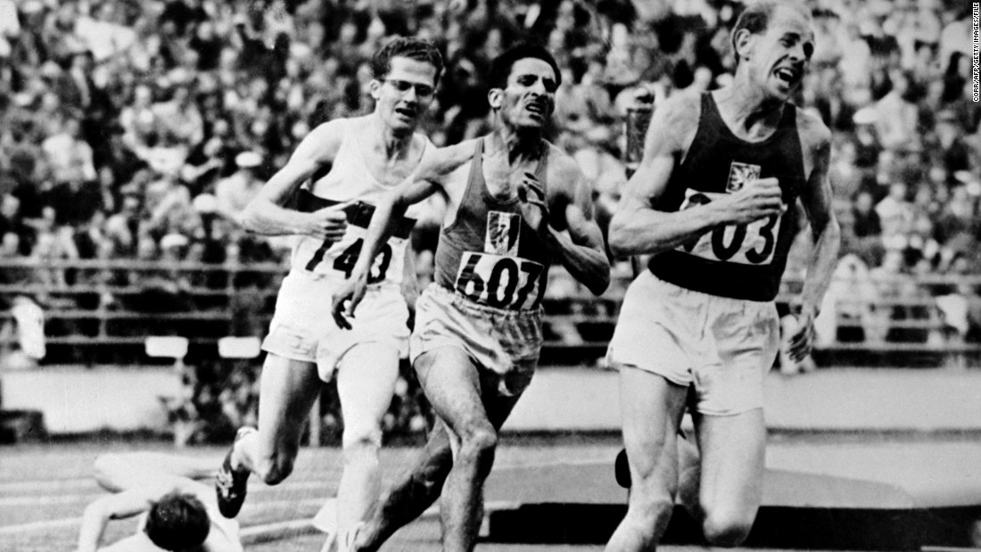 "Emil Zatopek (right) of Czechoslovakia was the ""iron man"" in Finland's first Games, <a href=""/2012/08/11/sport/london-olympics-zatopek-marathon/"" target=""_blank"">taking gold in the 5,000 and 10,000 meters and the marathon</a> -- the only Olympian to have achieved the grueling feat."