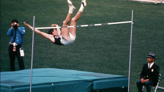 "American Dick Fosbury changed the high jump forever by claiming the gold medal with his revolutionary ""Fosbury Flop"" technique. It has since become the dominant technique in the event."