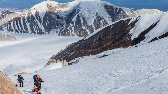 "There's no such thing as ""light and fast"" on Denali. With the food, fuel and cold-weather clothing required for a three-week expedition, packs can weigh 60-80 pounds. Until much of the food and fuel is spent on lower elevations, climbers use sleds to haul gear up the mountain."