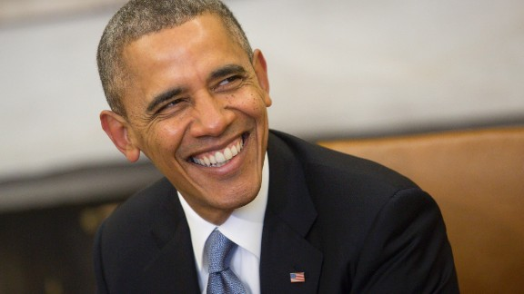WASHINGTON, DC - FEBRUARY 11:  (AFP OUT) U.S. President Barack Obama smiles as he meets with French President Francois Hollande in the Oval Office at the White House on February 11, 2014 in Washington, DC. Hollande who arrived yesterday for a three day state visit, visited Thomas Jefferson's Monticello estate and will be the guest of honor for a state dinner tonight.  (Photo by Andrew Harrer-Pool/Getty Images)
