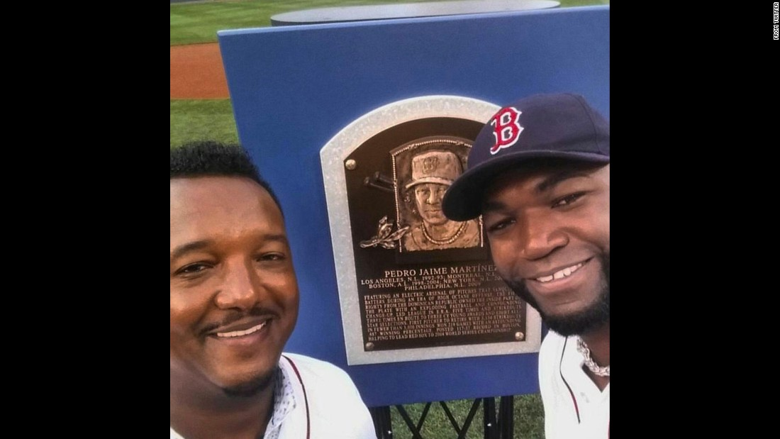 "Boston Red Sox slugger David Ortiz, right, <a href=""https://twitter.com/davidortiz/status/626391815852179457"" target=""_blank"">congratulates his former teammate, Pedro Martinez,</a> as they stand in front of Martinez' Hall of Fame plaque on Wednesday, July 29."