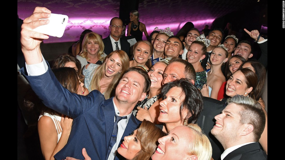 "Actor Channing Tatum takes a photo with guests at the annual <a href=""http://dizzyfeetfoundation.org/celebration-of-dance/"" target=""_blank"">Celebration of Dance Gala</a>, which raised money for dance education on Saturday, August 1, in Los Angeles."