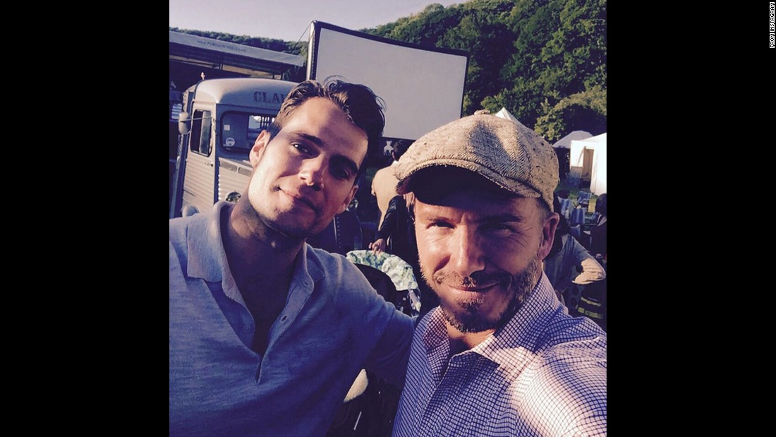 "Former soccer star David Beckham, right, takes a photo with actor Henry Cavill on Saturday, August 1. ""Always good to spend time with Superman,"" <a href=""https://instagram.com/p/51i59KTWdI/"" target=""_blank"">Beckham said on Instagram.</a>"