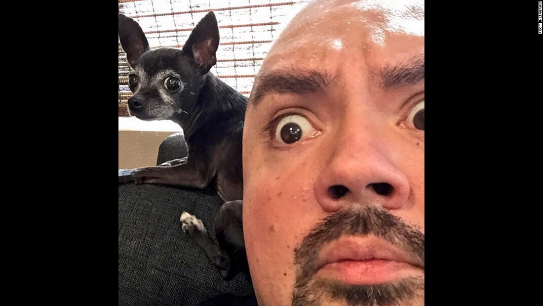 "Comedian Gabriel Iglesias <a href=""https://instagram.com/p/58Auq9DfmL/"" target=""_blank"">takes a selfie with a dog</a> on Monday, August 3."