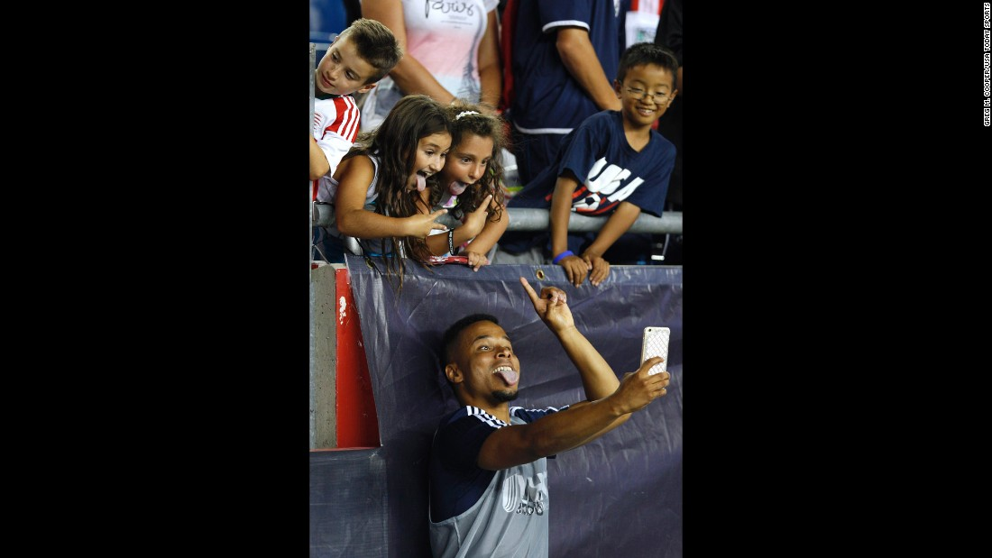 Charlie Davies, a forward for the New England Revolution, takes a selfie with soccer fans after a victory in Foxborough, Massachusetts, on Saturday, August 1.