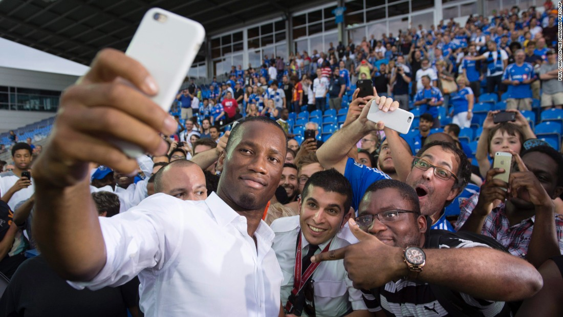Soccer star Didier Drogba also shows some love to fans after he was unveiled as the Montreal Impact's newest signing on Thursday, July 30.