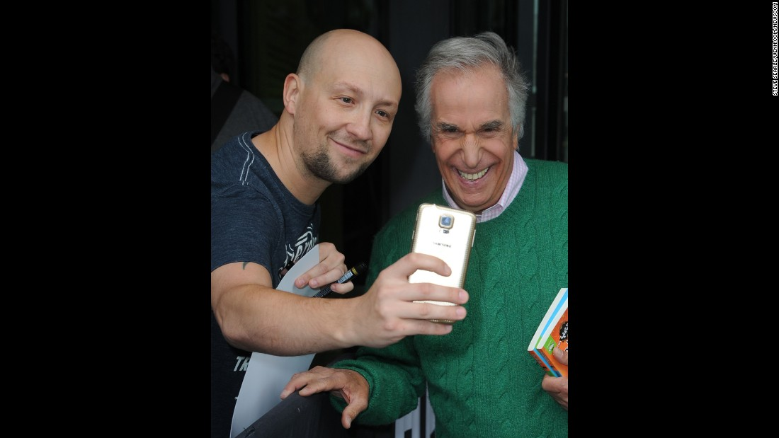 "A fan gets a photo with ""The Fonz"" -- actor Henry Winkler -- after Winkler appeared on a show in Manchester, England, on Thursday, July 30."