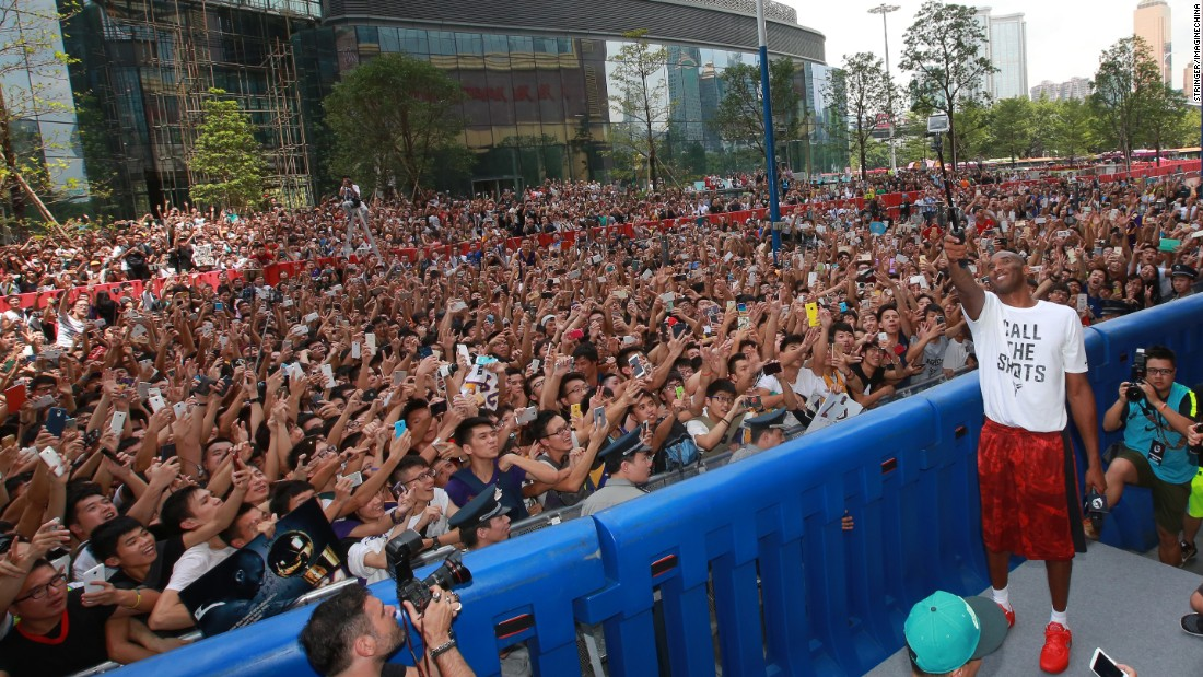Basketball star Kobe Bryant uses a selfie stick at a Nike event in Guangzhou, China, on Sunday, August 2.