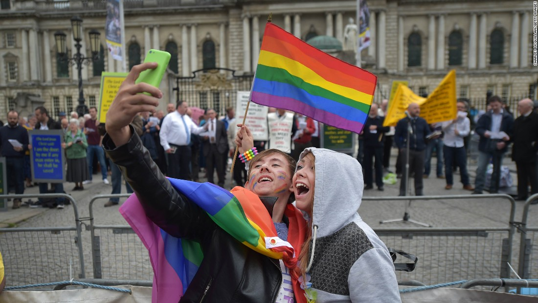 "During the Belfast Pride parade in Belfast, Northern Ireland, a couple takes a selfie in front of people who are protesting homosexuality on Saturday, August 1. <a href=""http://www.cnn.com/2015/07/29/living/gallery/selfies-look-at-me-0729/index.html"" target=""_blank"">See 22 selfies from last week</a>"