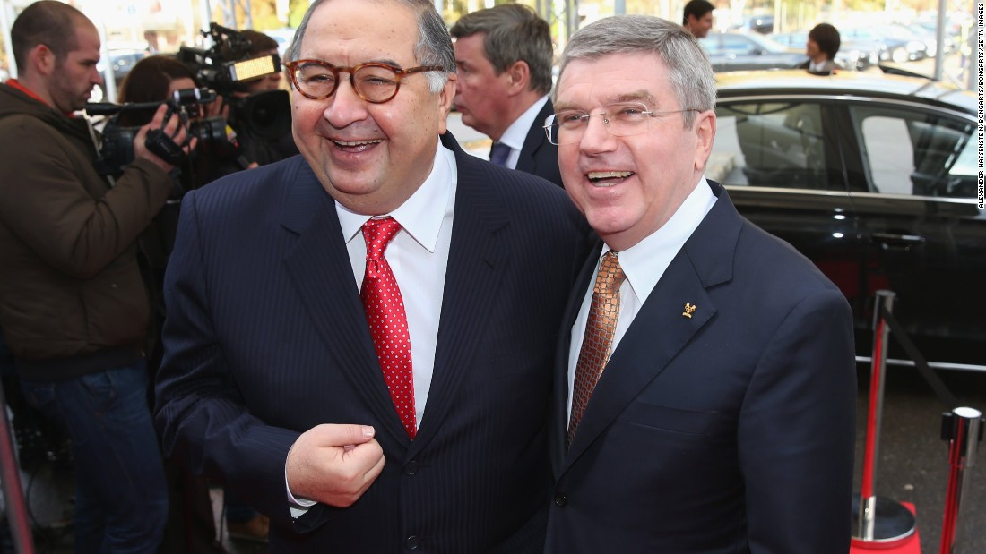 Usmanov, the fencing champion of Uzbekistan three times in his youth and current head of the International Fencing Federation, is pictured alongside IOC President Thomas Bach, who won Olympic gold in fencing in 1976.