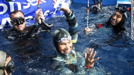 Russian freediver Natalia Molchanova shows the minus-86-meter tag that made her a world champion on September 3, 2005 in Villefranche-sur-Mer.