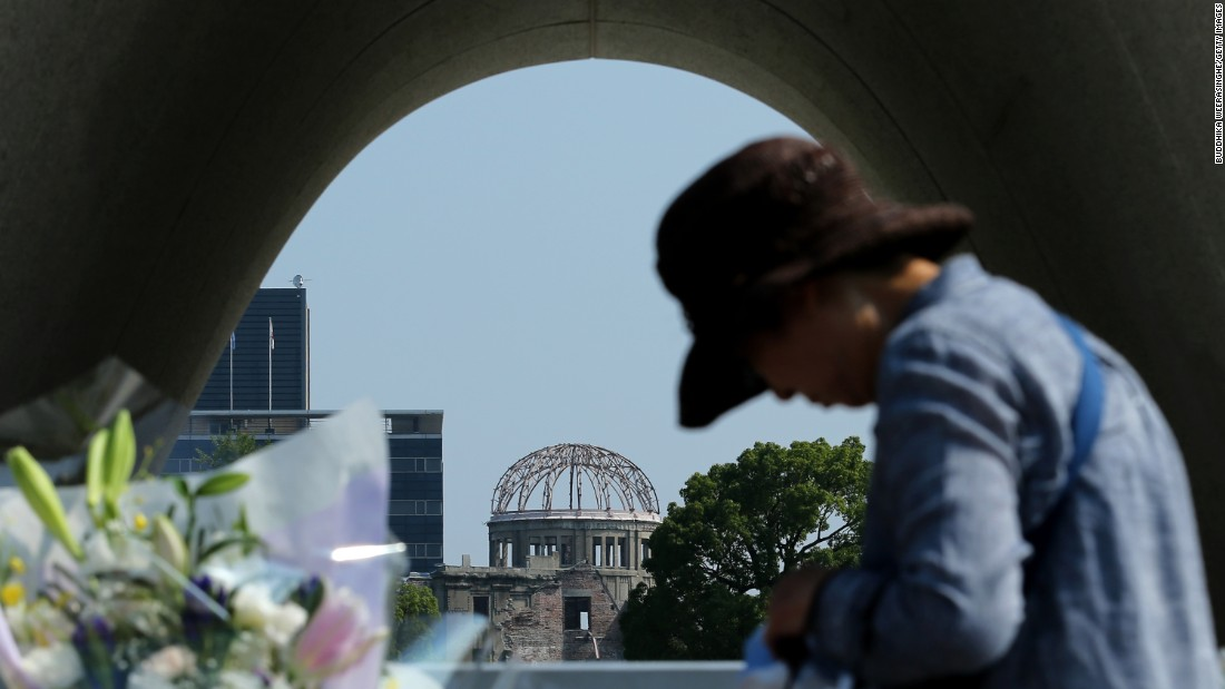 A woman prays Wednesday, August 5, at the Hiroshima memorial park.
