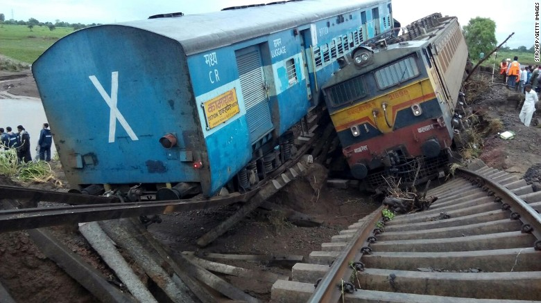 2 trains swept off flooded bridge in India