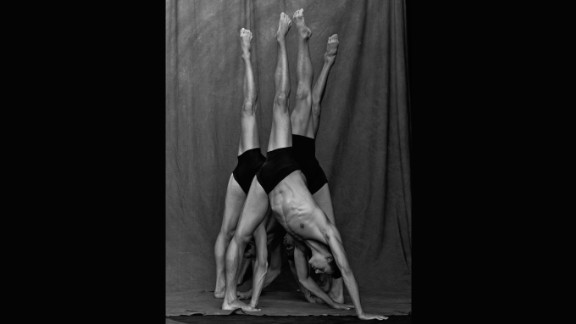 This shows dancers forming a kind of mirror image of each other. With the dancers extending one leg in the air while their other rests firmly on the ground, Brookes compares the structure of the dancers
