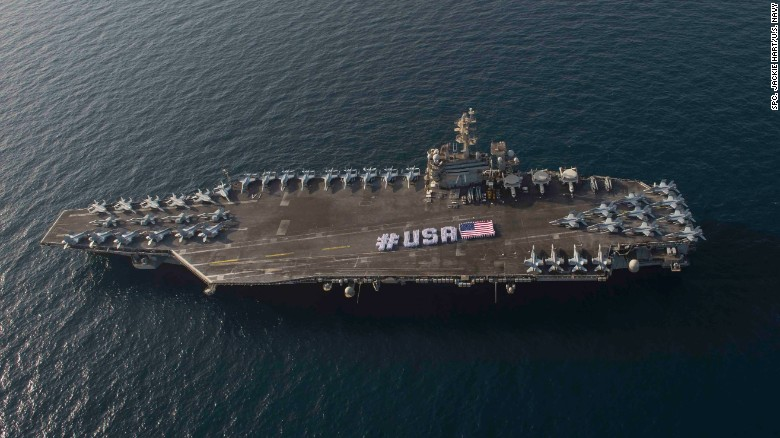 Second carrier to join us ships near korean peninsula cnnpolitics sailors spell out usa with the american flag on the flight deck of the nimitz sciox Gallery