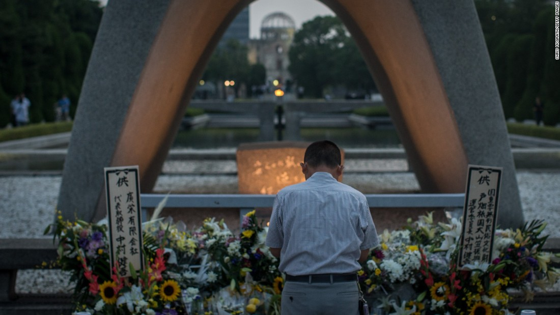A man prays at the memorial on August 6.