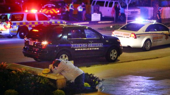 A man kneels across the street from the historic Emanuel African Methodist Episcopal Church in Charleston, South Carolina, following a shooting in June 2015. Police say the suspect, Dylann Roof, opened fire inside the church, killing nine people. According to police, Roof confessed and told investigators he wanted to start a race war. He was eventually convicted of murder and hate crimes, and a jury recommended the death penalty.
