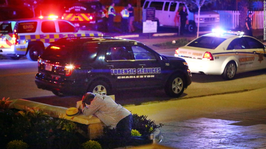 "A man kneels across the street from the historic Emanuel African Methodist Episcopal Church in Charleston, South Carolina, <a href=""http://www.cnn.com/2015/06/18/us/gallery/charleston-south-carolina-church-shooting/index.html"" target=""_blank"">following a shooting</a> in June 2015. Police say the suspect, Dylann Roof, opened fire inside the church, killing nine people. According to police, Roof confessed and told investigators he wanted to start a race war. <a href=""http://www.cnn.com/2017/01/10/us/dylann-roof-trial/index.html"" target=""_blank"">He was eventually convicted</a> of murder and hate crimes, and a jury recommended the death penalty."