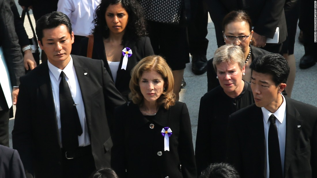 U.S. Ambassador to Japan Caroline Kennedy, center, leaves after a memorial ceremony at the Hiroshima Peace Memorial Park on August 6.