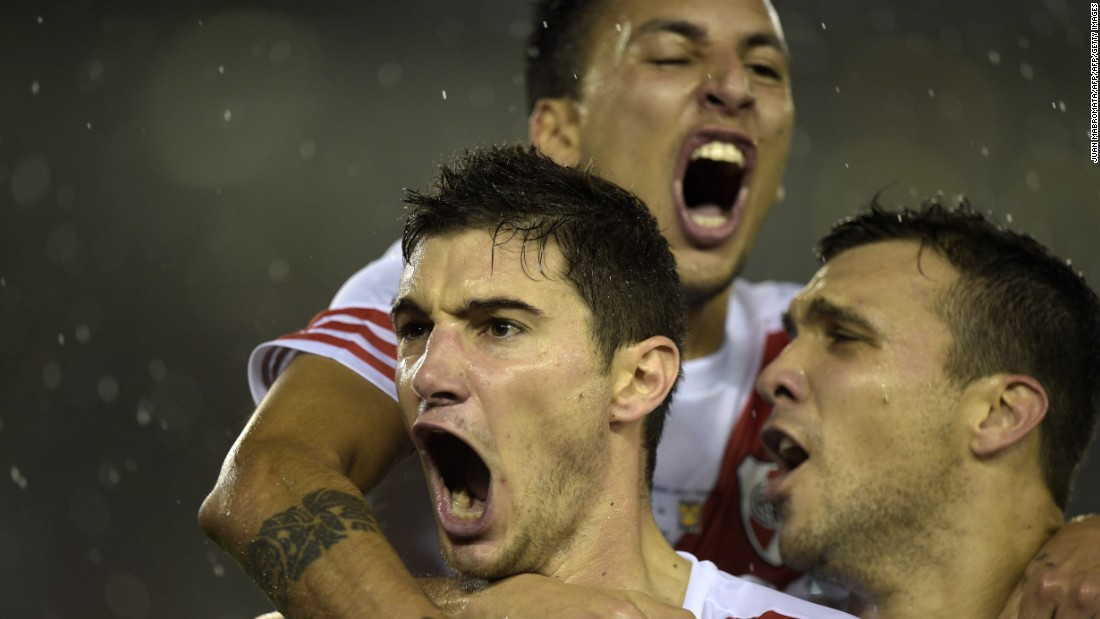 Lucas Alario (left) celebrates after opening the scoring for River on the stroke of half time on a wet night at the Monumental.