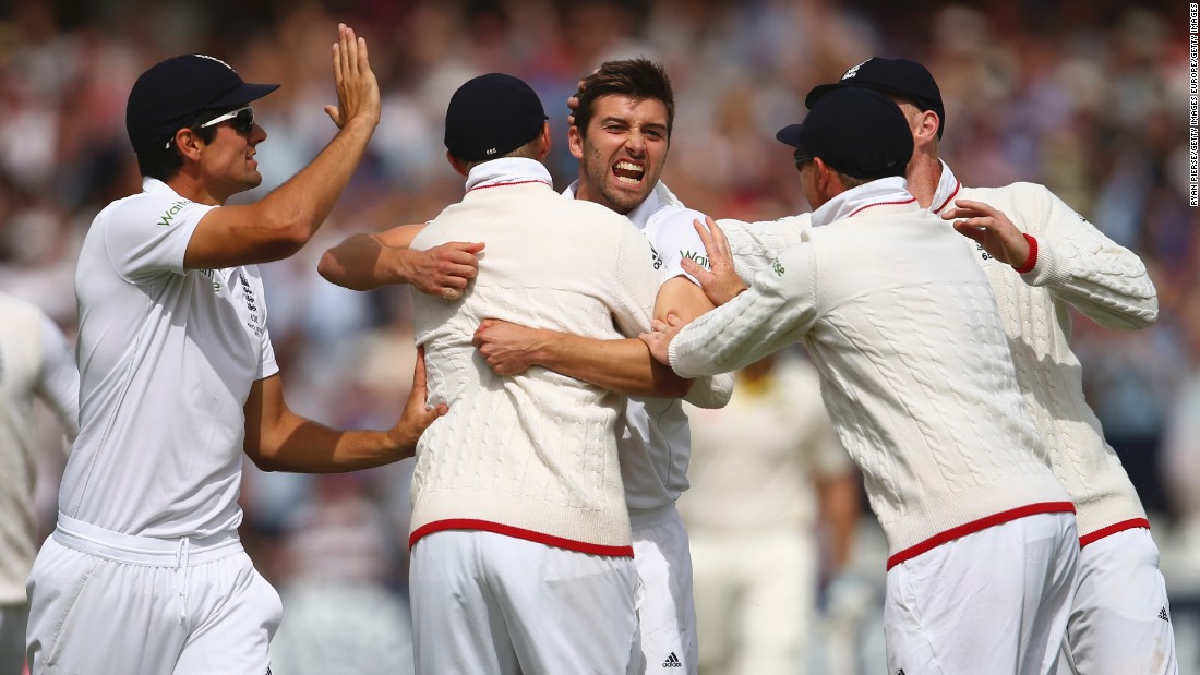 Second out: Mark Wood of England celebrates after taking the wicket of Australia's David Warner.