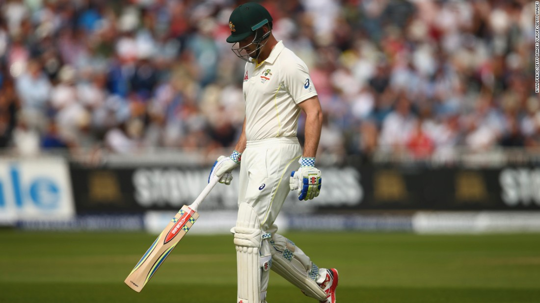 Fourth out: Shaun Marsh of Australia hangs his head after being dismissed by Broad.
