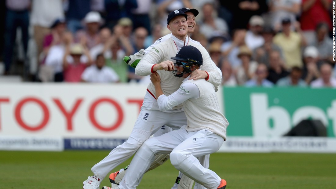 Sixth out: Ben Stokes of England celebrates with Jonathan Bairstow and Jos Buttler after catching out Adam Voges of Australia.