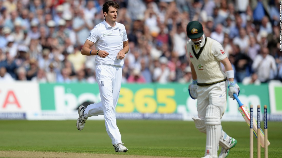 Seventh out: Steven Finn of England celebrates taking Peter Nevill's wicket.
