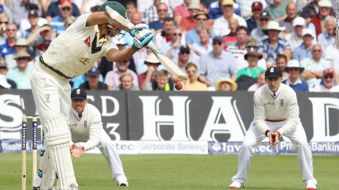 Ninth out: Australia's Mitchell Starc (L) tips the ball into the waiting hands of England's Joe Root (R).