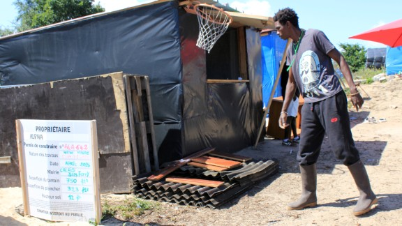 Some local residents, resigned to staying in the camp at least semipermanently, have taken jobs. This is Alpha, from North Africa, who has become the local builder. He uses materials donated by local French people.