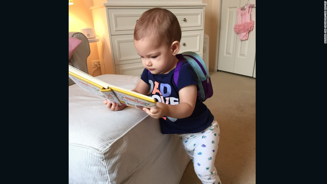 Chicago 1-year-old Juliana can't even walk yet but loves her backpack and books.
