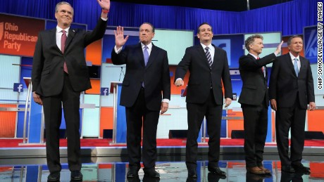 Republican presidential candidates (L-R) Jeb Bush, Mike Huckabee, Sen. Ted Cruz (R-TX), Sen. Rand Paul (R-KY) and John Kasich take the stage for the first prime-time presidential debate hosted by FOX News and Facebook at the Quicken Loans Arena August 6, 2015 in Cleveland, Ohio.