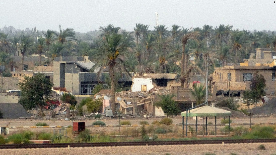 Buildings reduced to piles of debris can be seen in the eastern suburbs of Ramadi on August 6.