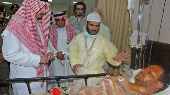 The governor of the Asir region in Saudi Arabia, Prince Faisal bin Khaled bin Abdulaziz, left, visits a man who was wounded in a suicide bombing attack on a mosque in Abha, Saudi Arabia, on August 6. ISIS claimed responsibility for the explosion, which killed at least 13 people and injured nine others.
