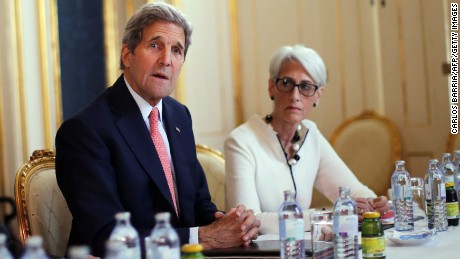 Wendy Sherman as US Under Secretary for Political Affairs next to Secretary of State John Kerry in Vienna in 2015