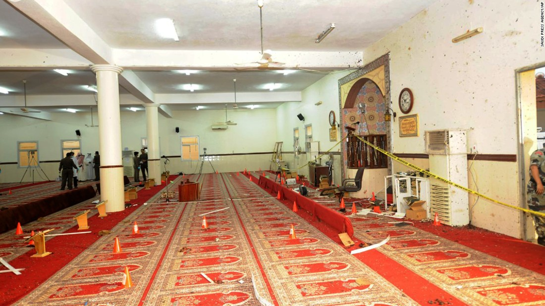 Saudi officials and investigators check the inside of the mosque on August 6.