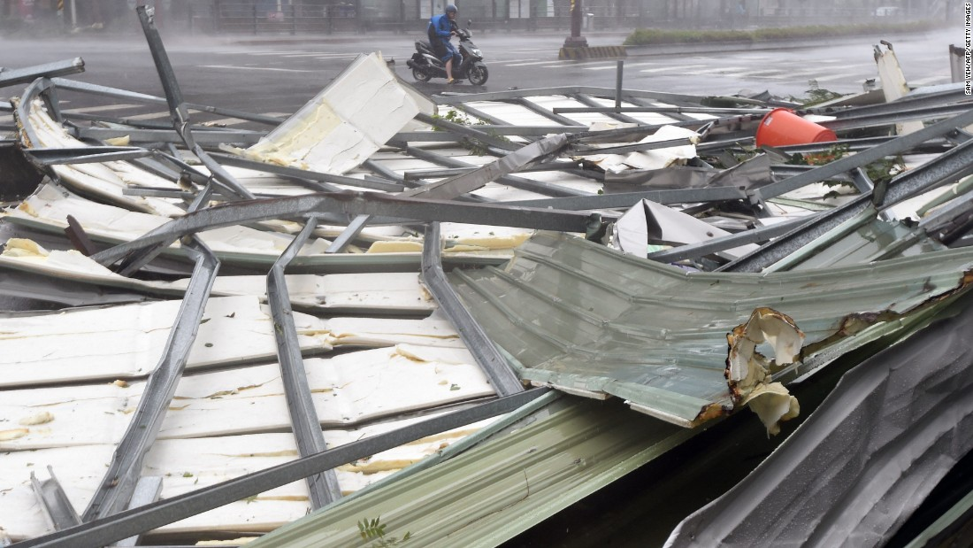 Metal sheeting lies on a Taipei road after the arrival of Typhoon Soudelor early on August 8.