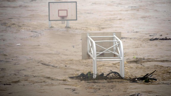 A basket stadium is flooded by the Jingmei River on August 8. More than 3 feet of rain fell in parts of Taiwan Saturday, CNN Meteorologist Ivan Cabrera said.