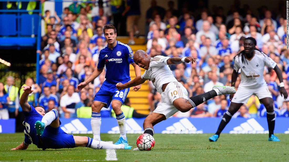 Ghanian  Andre Ayew of Swansea City draws the match at 1-1, rocketing the ball past defender John Terry of Chelsea.