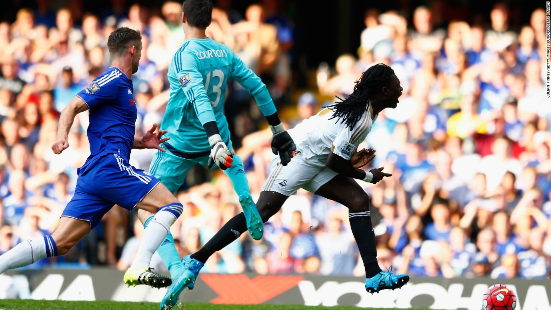 Bafetimbi Gomis of Swansea City is brought down by Thibaut Courtois of Chelsea, resulting in a red card and penalty during the Premier League match between Chelsea and Swansea City at Stamford Bridge on the opening weekend of the 2015-2016 campaign.