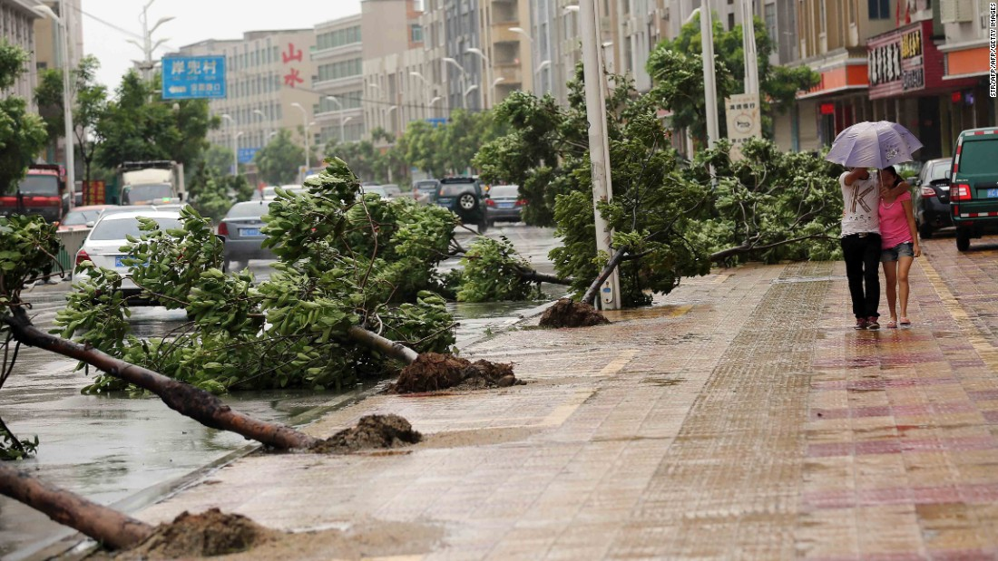 Trees torn down by strong wind are seen on the road in Jinjiang, China, on August 8.