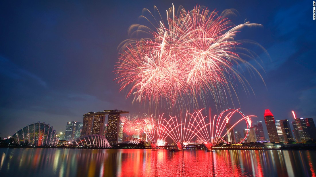"Fireworks explode above Singapore's financial skyline at dusk on Sunday, August 9, as part of celebrations for the nation's 50th year of independence. <a href=""http://www.cnn.com/2015/08/08/asia/singapore-turns-50/index.html"">Singapore</a>, a longtime British colony, became part of Malaysia in 1963 and declared its independence on August 9, 1965."