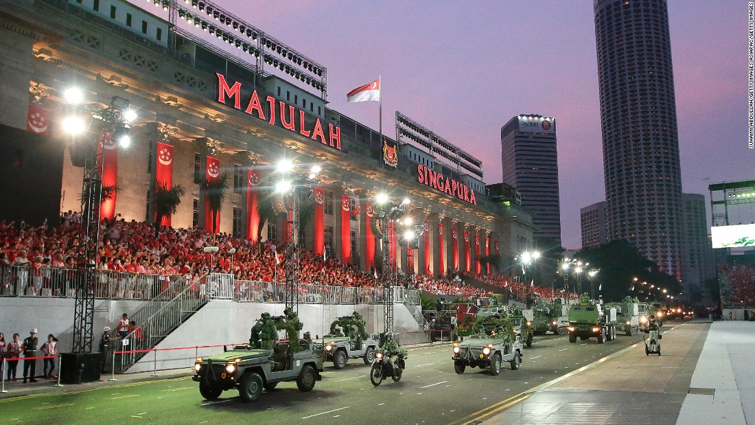 Military personnel roll past City Hall during the National Day Parade on August 9.