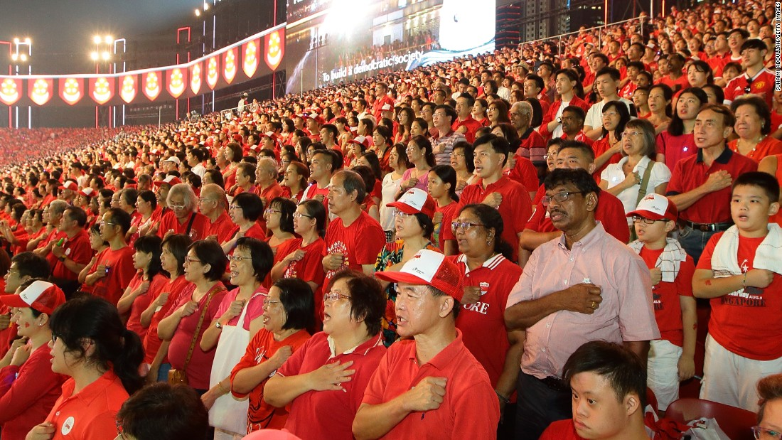 People recite the pledge at the end of the National Day Parade on August 9.